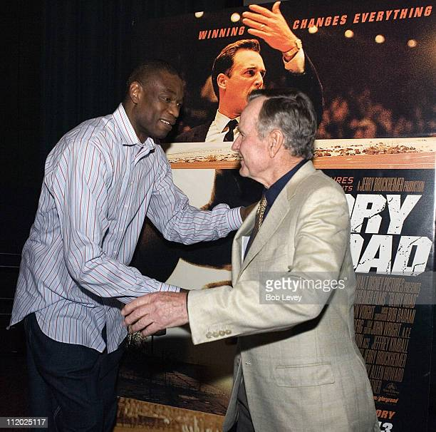 President George HW Bush welcomes Houston Rocket Dikembe Mutombo to a private screening of Disney's 'Glory Road' for local college basketball teams...