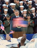 President George W Bush addresses crewmen returned from duty in Operation Enduring Freedom on the flight deck of the USS Enterprise 07 December 2001...