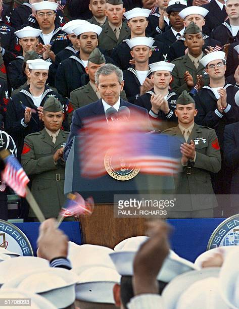 President George W Bush addresses crewmen returned from duty in Operation Enduring Freedom on the flight deck of the USS Enterprise 07 December 2001...