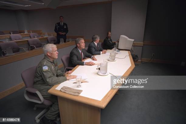 President George W Bush Admiral Richard Mies left and White House Chief of Staff Andy Card conduct a video teleconference Tuesday Sept 11 at Offutt...