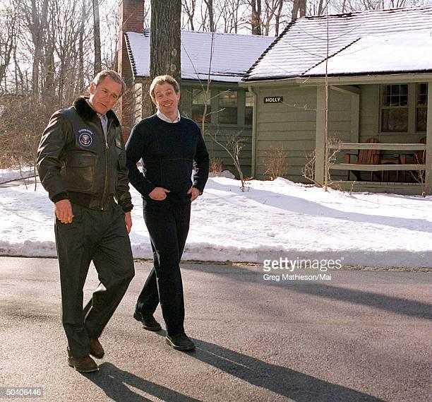 U S President George W Bush and British Prime Minister Tony Blair taking walk on grounds of presidential retreat Camp David