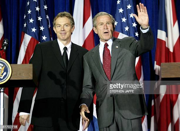 President George W Bush and British Prime Minister Tony Blair wave after their joint press conference at Crawford High School 06 April 2002 in...