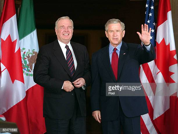 S President George W Bush and Canadian Prime Minister Paul Martin wave March 23 2005 during their arrival at the Armstrong Browning Library at Baylor...