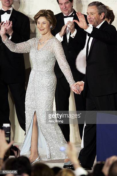 S President George W Bush and first lady Laura acknowledge the crowd at the Freedom Ball January 20 2005 at Union Station in Washington DC Bush was...