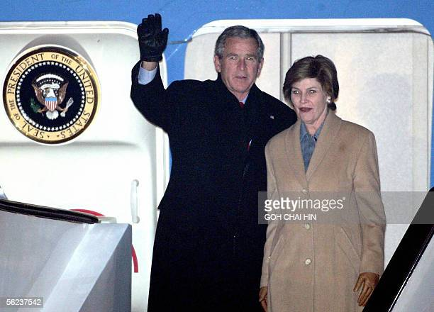President George W Bush and First Lady Laura arrive at the Beijing Capital International airport 19 November 2005 Bush arrived in Beijing for a...