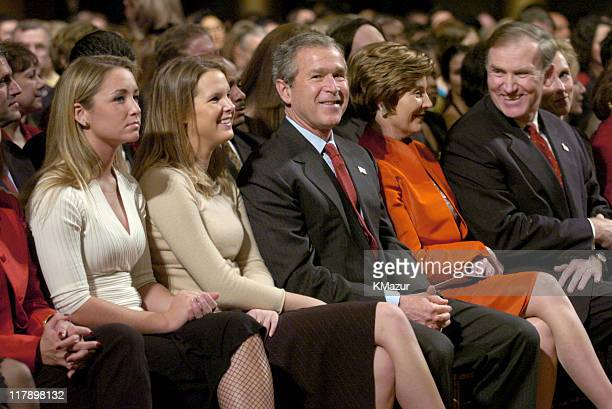 President George W Bush and First Lady Laura Bush and Robert Kimmitt Executive Vice President of Global Public Policy of Time Warner Inc