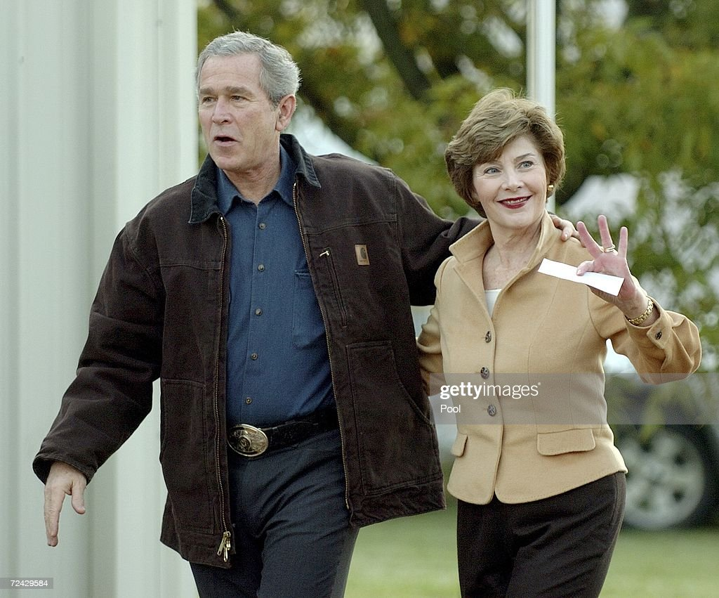 US President George W Bush and first lady Laura Bush arrive at the Crawford fire station to cast their ballots at the polling place November 7 2006...