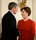 US President George W Bush and First Lady Laura Bush attend an event celebrating the first anniversary of the 'No Child Left Behind' Act in the East...