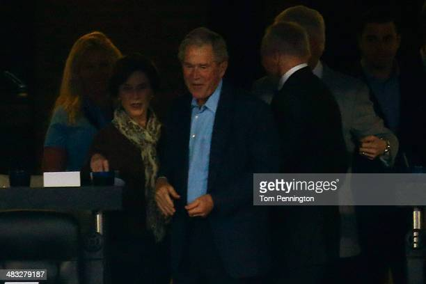 President George W Bush and first lady Laura Bush attend the NCAA Men's Final Four Championship between the Connecticut Huskies and the Kentucky...