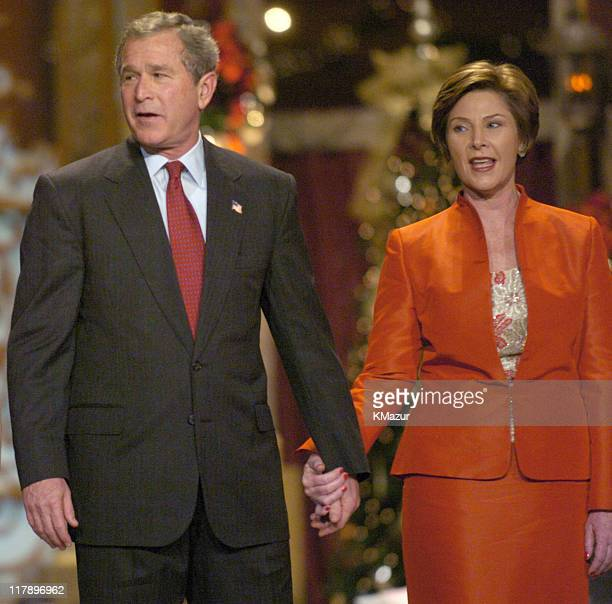 President George W Bush and First Lady Laura Bush during the finale on TNT's 'Christmas in Washington' Concert to air Sunday December 14 at 8pm ET/PT...