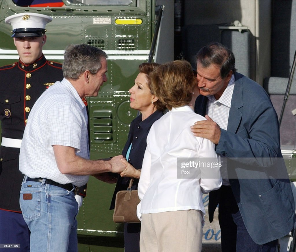S President George W Bush and first lady Laura Bush greet Mexico's President Vicente Fox and his wife Marta Sahagun after they arrived at Bush's...