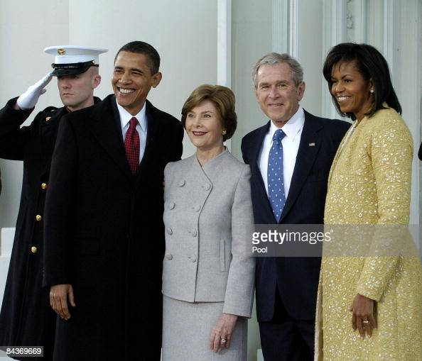S President George W Bush and First Lady Laura Bush pose with Presidentelect Barack Obama and Michelle Obama as they at the White House in the North...