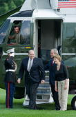 US President George W Bush and First Lady Laura Bush show the way to outgoing US White House Deputy Chief of Staff Joe Hagin to greet wellwishers who...