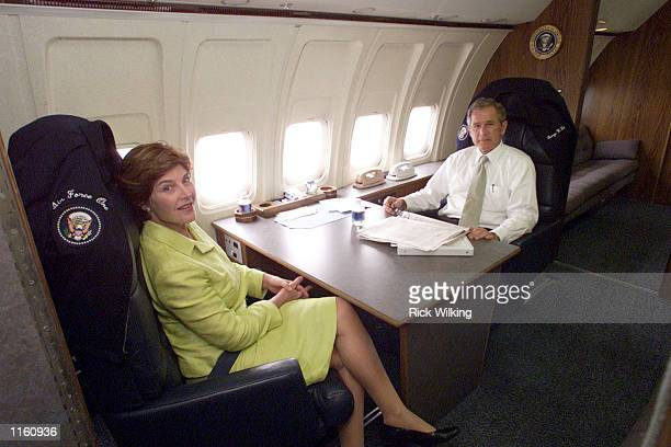 President George W Bush and first lady Laura Bush sit aboard Air Force One as the plane flies over Texas August 29 2001 on their return to Waco Texas...