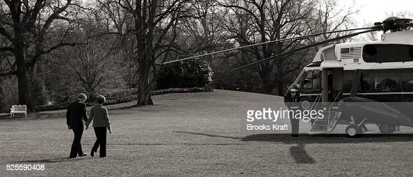 US President George W Bush and First Lady Laura Bush walk toward Marine One on the South Lawn of the White House in Washington January 20 2006 The...