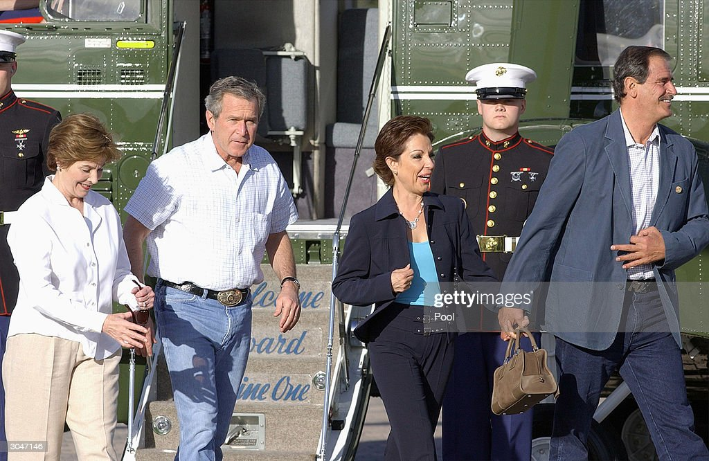 S President George W Bush and first lady Laura Bush walk with Mexico's President Vicente Fox and his wife Marta Sahagun after they arrived at Bush's...
