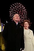 US President George W Bush and First Lady Laura Bush watch fireworks during the 'Celebration of Freedom' inaugural concert on the Ellipse south of...