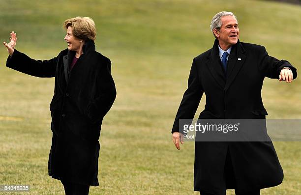 US President George W Bush and first lady Laura Bush wave as they return to the White House from a weekend at the presidential retreat at Camp David...