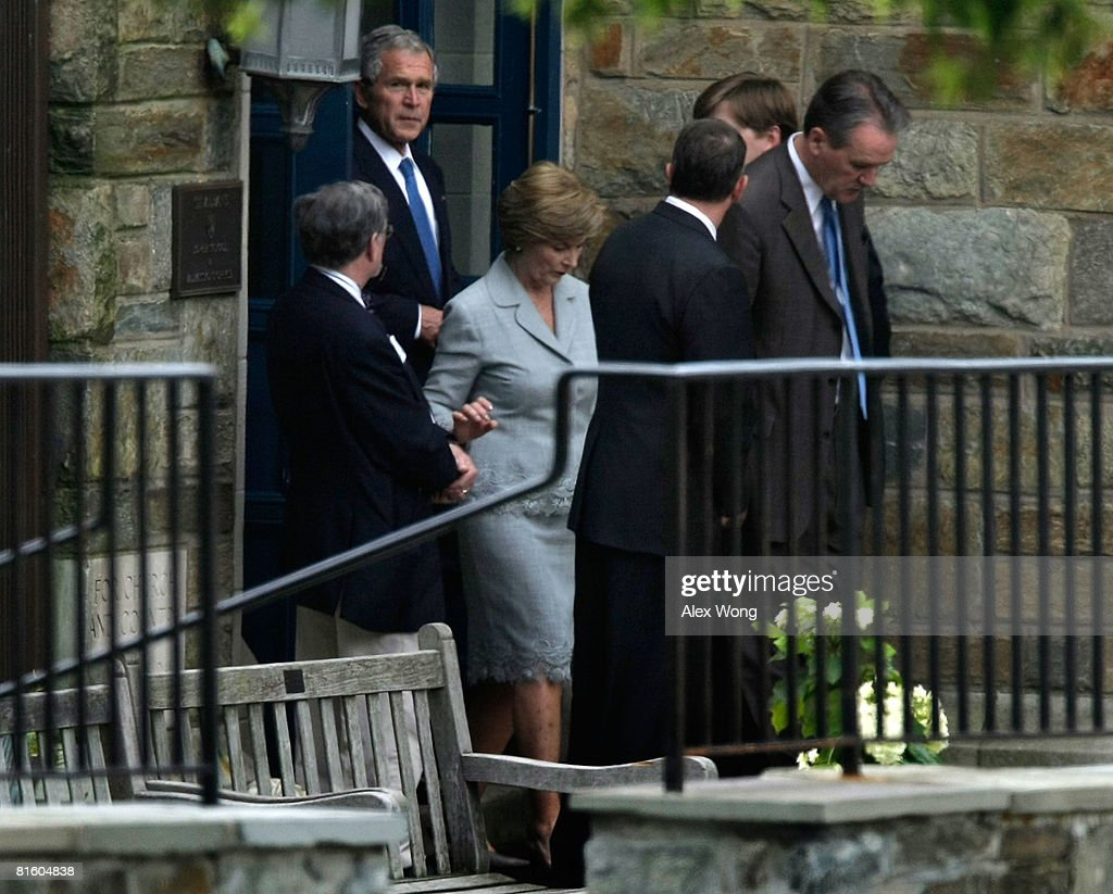 U.S. President George W. Bush (L) and first Laura (R) leaves after visiting the public viewing of late moderator of Meet the Press Tim Russert at St. Albans School June 17, 2008 in Washington, DC. A wake was held at the school for general public to pay their tribute to Russert who died June 13, 2008 of a heart attack while at the NBC bureau in Washington at the age of 58.