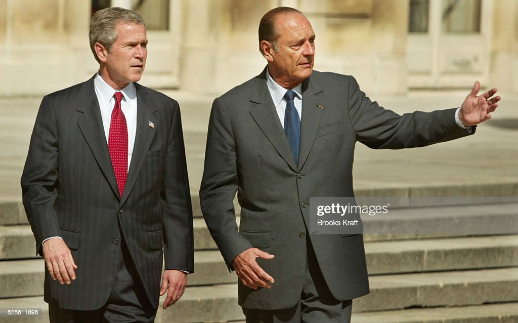 U.S. President <a gi-track='captionPersonalityLinkClicked' href=/galleries/search?phrase=George+W.+Bush&family=editorial&specificpeople=122011 ng-click='$event.stopPropagation()'>George W. Bush</a> and French President <a gi-track='captionPersonalityLinkClicked' href=/galleries/search?phrase=Jacques+Chirac&family=editorial&specificpeople=165237 ng-click='$event.stopPropagation()'>Jacques Chirac</a> hold a joint news conference at the Elysee Palace in Paris. After their private meeting they walk thru the gardens on the way to the press conference.