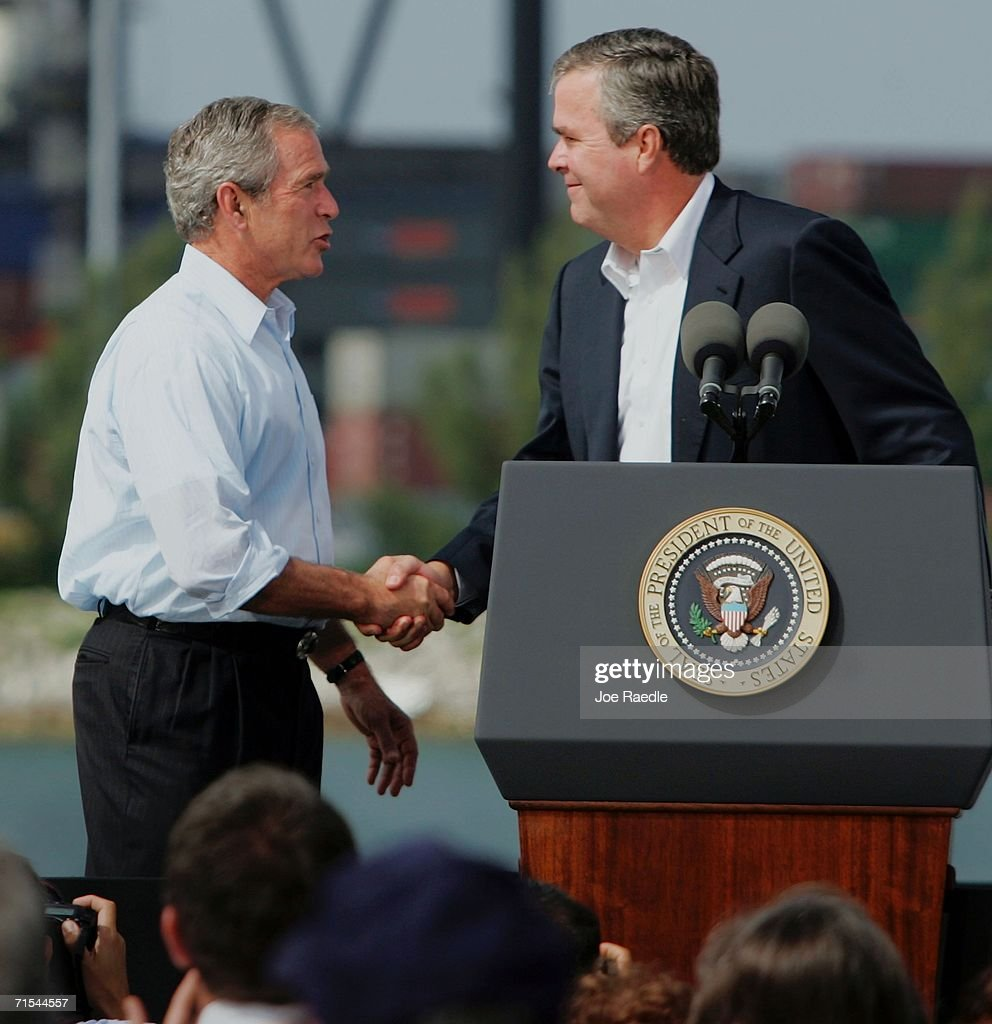 S President George W Bush and his brother Florida Governor Jeb Bush shake hands during a visit to the US Coast Guard station July 31 2006 in Miami...