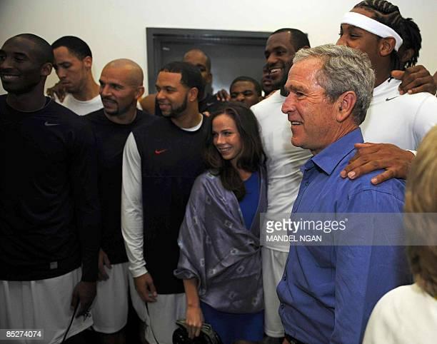 US President George W Bush and his daughter Barbara pose with US basketball players Kobe Bryant Tayshaun Prince Jason Kidd Deron Williams LeBron...