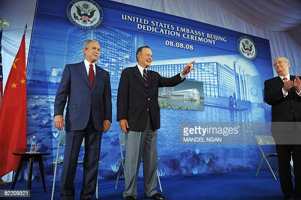 US President George W Bush and his father former US president George H W Bush are introduced by US Ambassador to China Clark Randt during the...