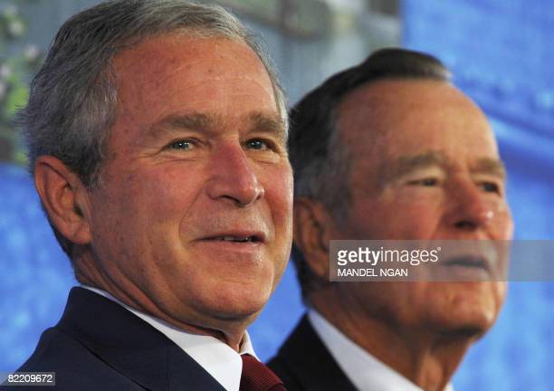 US President George W Bush and his father George H W Bush listen to a patriotic song by country music performers The Gatlin Brothers during the...
