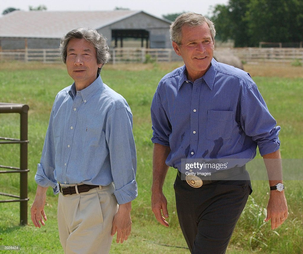 S President George W Bush and Japanese Prime Minister Junichiro Koizumi leave a media conference May 23 2003 on Bush's ranch near Crawford Texas...
