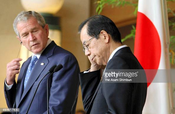 US President George W Bush and Japanese Prime Minister Yasuo Fukuda attend a joint press conference after their meeting on the sidelines of the G8...
