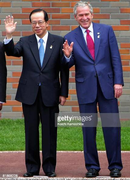 S President George W Bush and Japanese Prime Minister Yasuo Fukuda pose for the G8 leaders' Africa and International Organizations family photo...