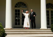 S President George W Bush and Pope Benedict XVI wave from the Colonnade after a arrival ceremony ceremony at the White House April 16 2008 in...