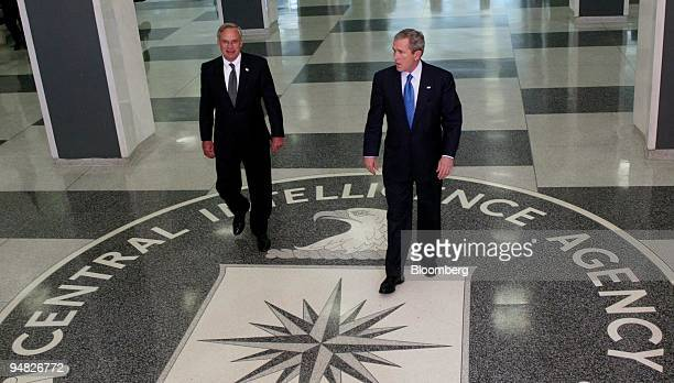 President George W Bush and Porter Goss director of the Central Intelligence Agency left arrive for a press conference after President Bush met with...