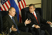 US President George W Bush and Russian President Vladimir Putin hold a bilateral discussion at the G8 Summit in Kananaskis