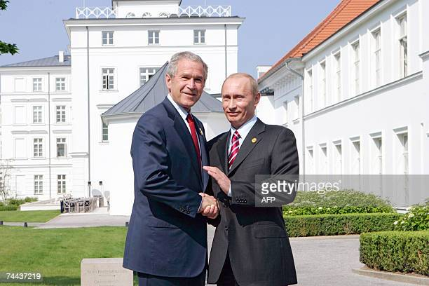President George W Bush and Russian President Vladimir Putin shakes hands 07 June 2007 before their bilateral meeting on the sidelines of the G8...