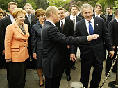 US President George W Bush and Russian President Vladimir Putin walk through Cathderal Square after holding a nuclear arms discussion at the Kremlin...