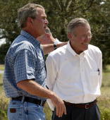 US President George W Bush and Secretary of Defense Donald Rumsfeld speak to the press at the President's Crawford Texas ranch 08 August 2003 The US...