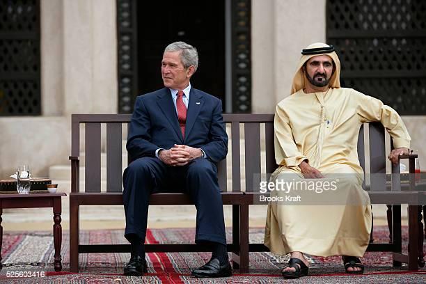 US President George W Bush and Sheikh Mohammed Bin Rashid alMaktoum watch children perform during Bush's visit to the Sheikh Saeed Al Maktoum House...