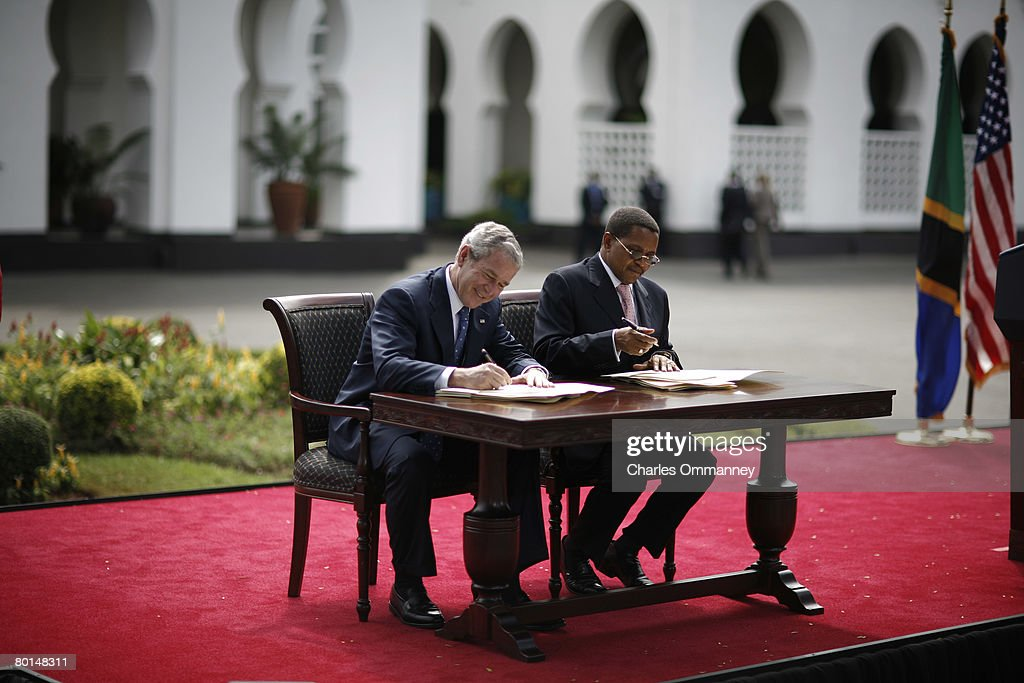 US President George W. Bush and Tanzania President Jakaya Kikwete chat while signing the Millennium Challenge Compact aide package February 17, 2008 at the State House in Dar es Salaam. The two leaders signed a five-year, 698-million-dollar US aid package for the east African country.