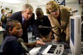 S President George W Bush and US Secretary of Education Margaret Spellings watch students Caleb Gray and Jordan Thomas in the 'Smart Lab' at the...