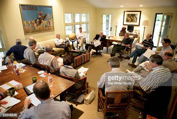 President George W Bush and Vice President Dick Cheney meet with economic advisors August 9 2005 at the president's ranch in Crawford Texas The break...