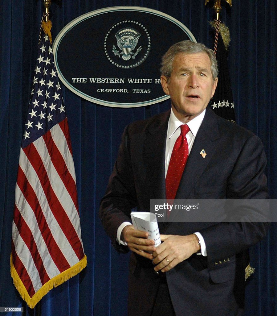 U.S. President George W. Bush answers questions about his New Year's plans following a news conference at his ranch December 29, 2004 near Crawford, Texas. President Bush spoke on a large number of issues including the aid for the Tsunami victims, Iraq elections as well as flooding on the West Coast.