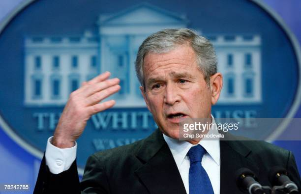 S President George W Bush answers questions from reporters during a press conference in the Brady Press Briefing Room at the White House December 4...