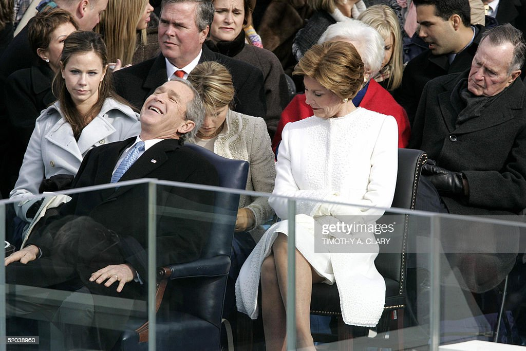 US President George W. Bush appears in his element amid family members during inaugural ceremonies on Capitol Hill 20 January 2005 in Washington, DC. Bush, 58, was sworn in by the ailing Chief Justice William Rehnquist in the 55th US presidential inauguration and the first since the 11 September 2001 terrorist attacks that transformed his time in office. From left are: daughter Jenna, Bush, brother and Florida Governer Jeb Bush; daughter Barbara; First Lady Laura; mohher and former first lady Barbara (obscured); father and former US president George H.W. Bush. AFP PHOTO/Timothy A. CLARY
