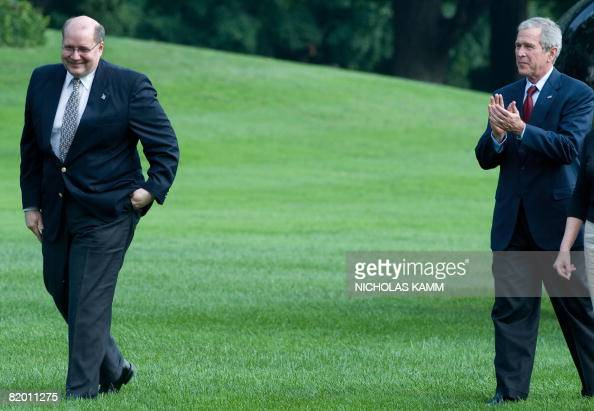 US President George W Bush applauds outgoing US White House Deputy Chief of Staff Joe Hagin as he makes his way to greet wellwishers who came to bid...
