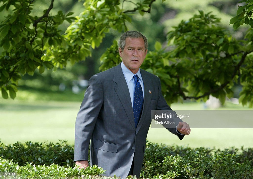 S President George W Bush arrives to speak about the healthy forests initiative at the East Garden of the White House May 20 2003 in Washington DC...