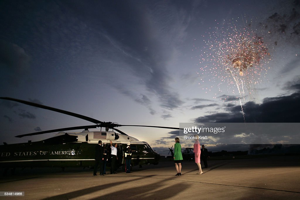 US President George W Bush boards Marine One after attending a campaign rally in Sugar Land Texas Seeing him off are Senator Kay Bailey Hutchison and...