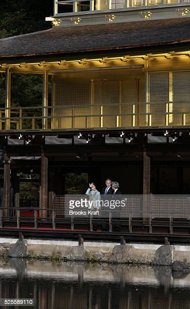 US President George W Bush center and first lady Laura Bush left visit the Kinkakuji Temple also known as the Golden Pavilion with Japan's Prime...
