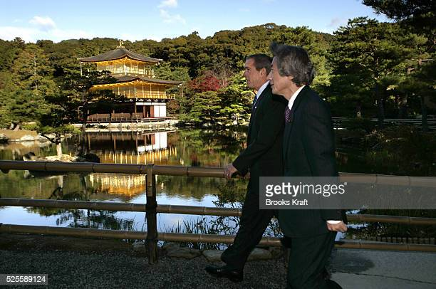 US President George W Bush center and Japanese Prime Minister Junichiro Koizumi right visit Rokuonji Temple known as Kinkakuji Temple in Kyoto Japan...