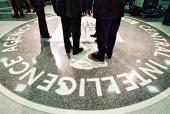 President George W Bush Central Intelligence Agency Director George Tenet and others stand on the seal of the Agency March 20 2001 at the CIA...